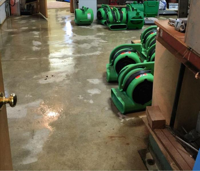 Green drying equipment on a wet concrete floor