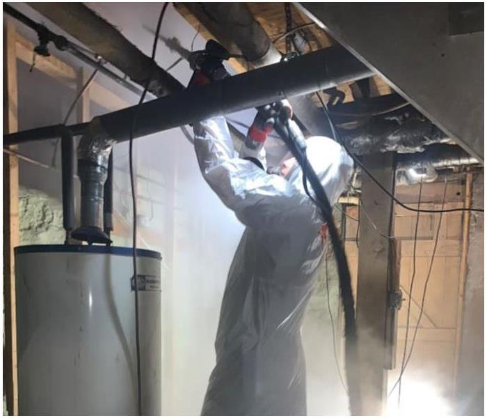 man in PPE dry ice blasting
